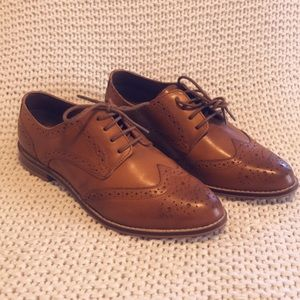 Brown leather oxfords.